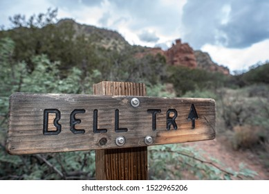 Wooden trail marker gives directions for hikers hiking Bell Trail