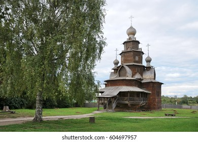 Wooden Transfiguration Church with a Birch Tree on the First Day of Autumn on the grounds of the Museum of Wooden Architecture at the beginning of calendar Autumn. Suzdal, Russia.