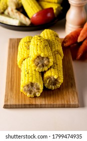 Wooden Tray with Corn Healthy Vegan Dinner Vertical
