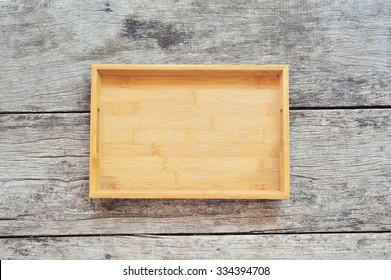 Wooden tray on wood background.