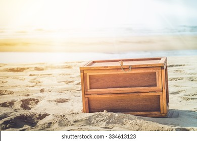 Wooden Treasure Box On The Beach With Sun Beam