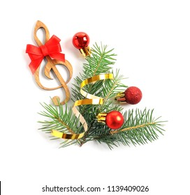 Wooden treble clef and decorations on white background. Christmas music concept