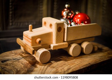 wooden truck with red and orange christmas balls; christmas present for kid;