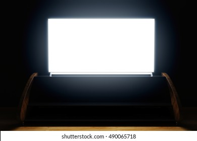 Wooden TV stand and empty illuminated flat screen in dark room. Front view, Mock up, 3D Rendering