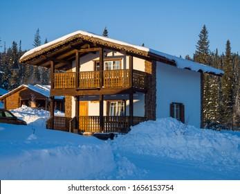 Wooden two-story Alpine-style house. Hotel in the ski resort Gornaya Salanga. Winter day