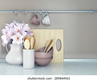 Wooden utensils and flowers on the white marble worktop.