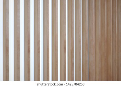 Wooden vertical lath in warm pastel color, Japanese style.