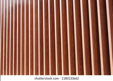 Wooden vertical slats on a wall background. Interior detail, texture, background. The concept of minimalism and Scandinavian style in the interior. Copy space