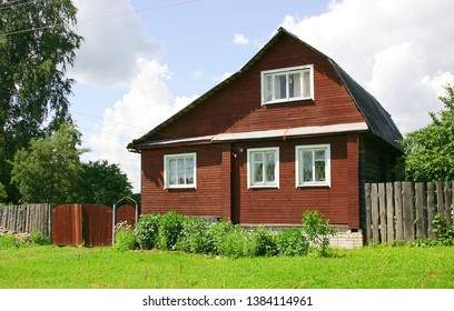 Wooden village house on a clear summer day, Tver region, Russia