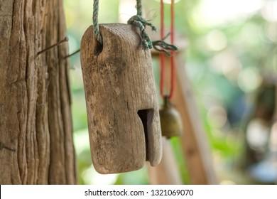 Wooden vintage bell  hanging on wood pole