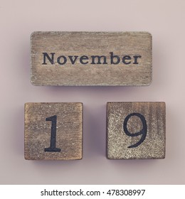 Wooden vintage calendar showing the date 19th of November