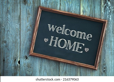 wooden vintage frame WELCOME HOME over old blue wooden background
