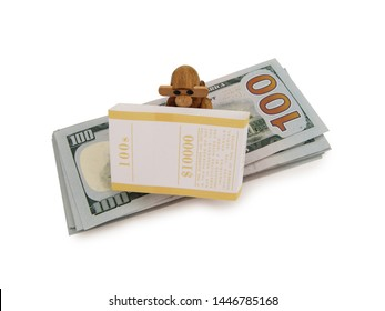 Wooden Vintage Monkey Figurine Sitting On A Stack Of Hundred Dollar Bills Over A White Background