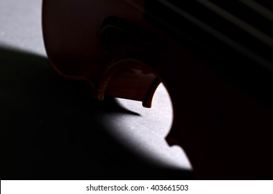 wooden violin part on black background, macro