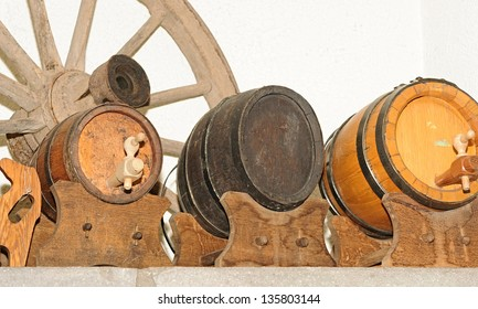 Wooden wagon wheel and antique wooden small beer keg