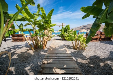Wooden walk lined with banana trees to Vlycha beach near Lindos village (Rhodes, Greece)