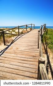 wooden walkboard at mediterranean beach of Denia,Spain