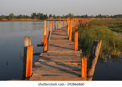 Wooden walking bridge landscape under evening sun light.