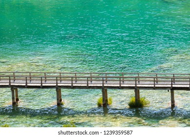 Wooden walking bridge in paradise turquoise waters