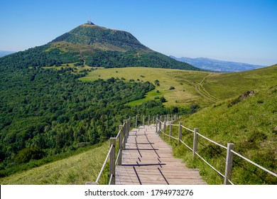 wooden walking pathway in puy de dome french mountain volcano in summer day