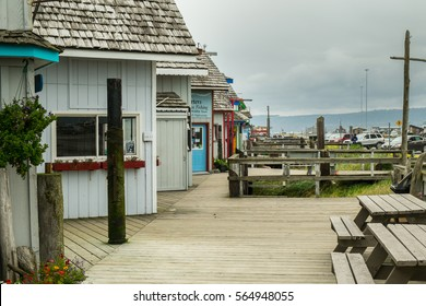 Wooden walking promenade close to shops and attractions for tourist in world capital of halibut in town of Homer in Alaska during windy and cloudy autumn day during holiday