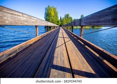 Wooden walkway across a water