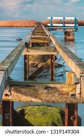 Wooden walkway across water to island. Utvalinge, Sweden.