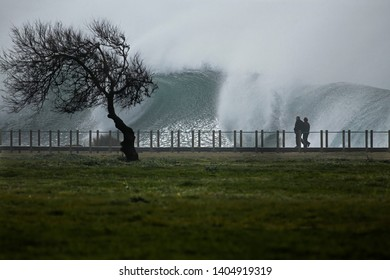 Wooden walkway along Portuguese coast during sea storm