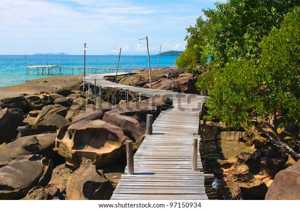 Wooden walkway along the shore. Island Koh Kood, Thailand .
