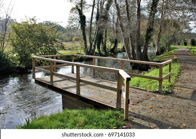 Wooden walkway for fishermen, Walking along a river road with leaves of fallen trees in autumn, Near the river Xubia, San Sadurniño, A Coruna, Galicia, Spain, places and landscapes unknown,