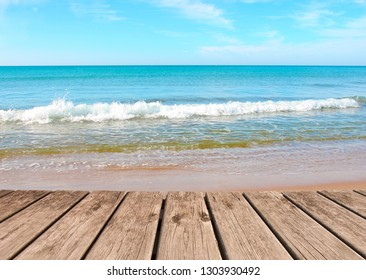 wooden walkway next to the beach