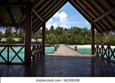 Wooden walkway to the ocean pier