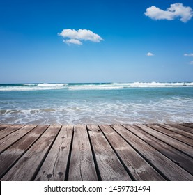 Wooden walkway on the tropical beach at sunny day
