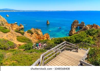 Wooden walkway to Praia do Camilo beach, Algarve region, Portugal