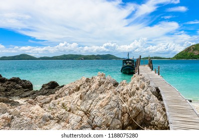Wooden Walkway, Rocky coast and White sand beach with blue sea on KohKham. Sattahip, Chonburi, Thailand