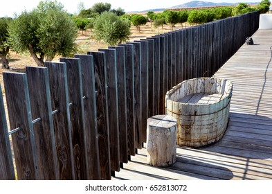 Wooden walkway with a wooden water cooler made of wood