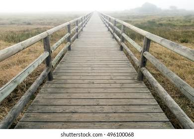 Wooden walkway, which is lost in the fog. Town of Tarifa, Spain.