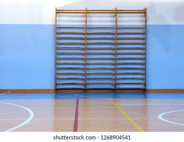 wooden wall bars in the big empty gym without the athletes