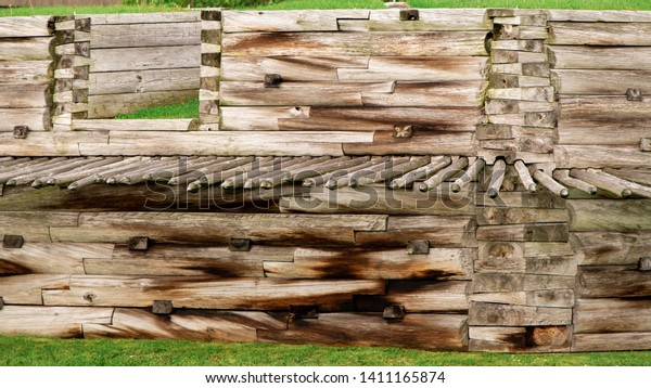 A Wooden Wall with a battlement and wood stakes at Fort Stanwix in Rome New York