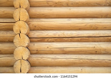 Wooden wall of blockhouse. Brown rustic wooden texture background. Facade of a log house, copy space
