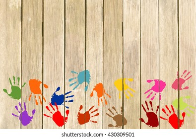 wooden wall with colorful handprints