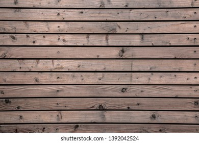 Wooden wall or fence made of wooden boards