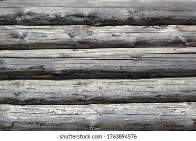 Wooden wall from logs. Horizontal background texture