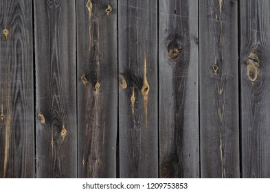 Wooden wall of a old house with gray boards