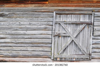 Wooden wall of an old house with single door