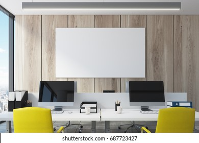 Wooden wall open space office interior with a large window, a long table with two computer monitors on it and a horizontal poster. Close up. 3d rendering mock up