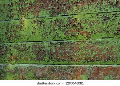 wooden wall of planks with peeling green paint - Shutterstock ID 1293646081