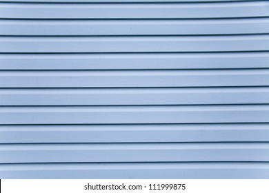 Wooden wall. Slice the blue siding