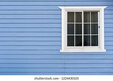 Wooden wall with windows frame.