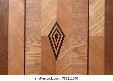 Wooden wardrobe door with intarsia ornament